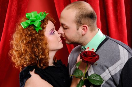 Each of the folks take turns smooching and blowing