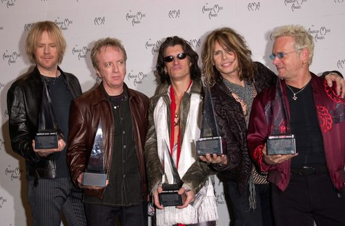 Hey, I've got most of Aerosmith's albums and I can't name more than one person in the band... - DNL