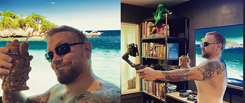 Dr. NerdLove faking being on a tropical vacation with a TV backdrop and selfie stick