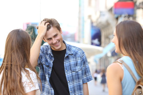 Nervous young man attempts to flirt with two ladies