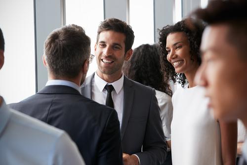 Group Of Businesspeople Having Informal Office Meeting