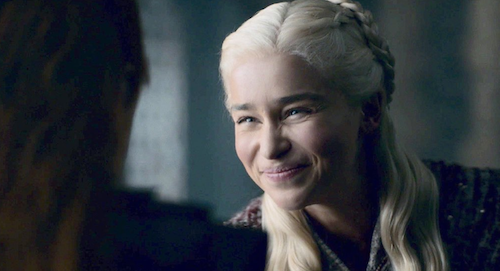 Emilia Clarke as Daenarys Targaryan, squinting