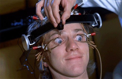 """Malcom McDowell undergoing the ludovico technique in """"A Clockwork Orange"""" — his eyes pried open and wearing a mind-altering headgear"""