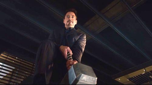 Robert Downey Jr. as Tony Stark, trying to lift Mjolnir