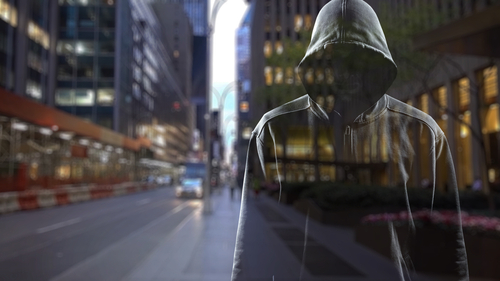 semi-transparent man with no visible face in a grey hoodie, on a cityscape background