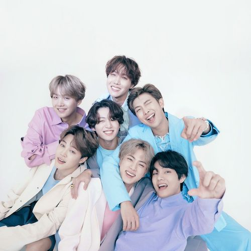 Korean boy band BTS piled on top of each other for a photo shoot