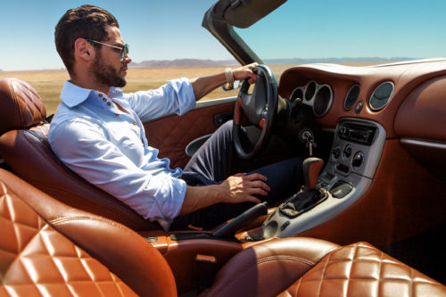 Handsome man driving exotic sports car