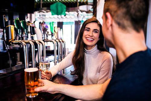 cute couple having a drink at a bar