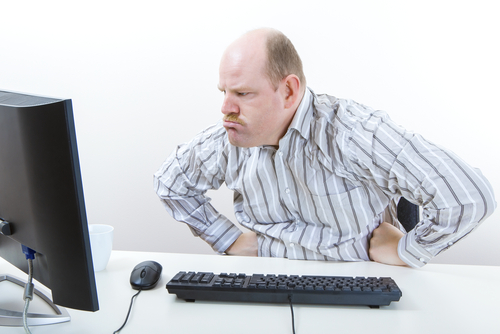Angry Businessman Looking At Computer On Desk