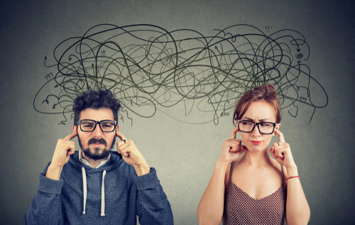 Man and woman with fingers in their ears, scribbles over their head indicating displeased thoughts