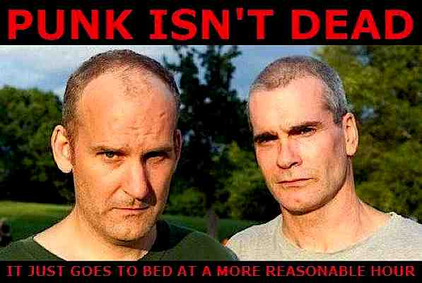 """Picture of Jello Biafra and Henry Rollins. Text reads """"Punk Isn't Dead. It just goes to bed at a more reasonable hour."""""""