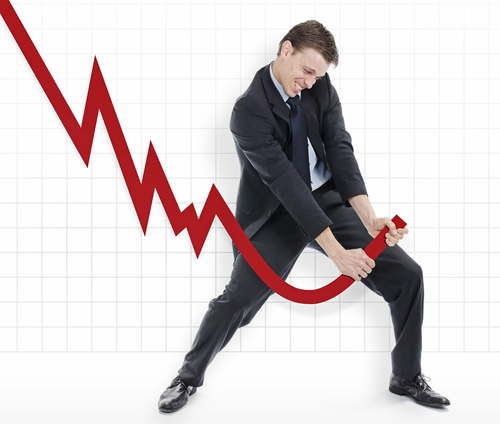 Man grabbing declining graph and trying to twist it upwards.